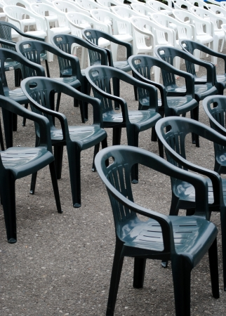 rows of plastic chair ready for a show Stock Photo