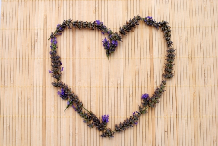 placemat: Heart made of lavender flowers, on a bamboo placemat Stock Photo