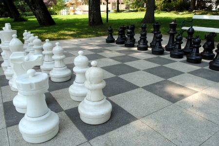 big game: big chess set in the park with benches