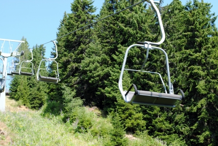 top down car: mountain chair lift with two places for people
