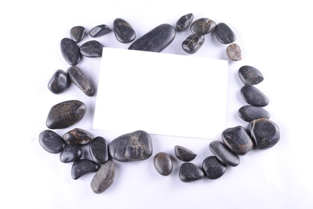 black zen stones and a white card, soft shadows photo