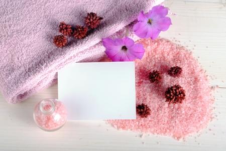 businness: bath salt, flowers and a blank card, concept of wellness