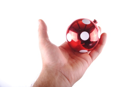 man hand holding a red christmas ball, isolated on white