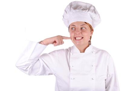femmina cuoco executive punto la guancia, isolato su bianco Archivio Fotografico