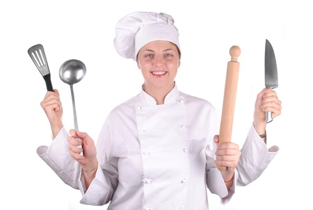 serious young female chef with four hands, isolated on white photo