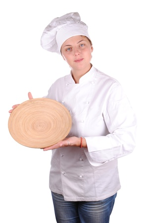 young female chef showing a wooden dish, isolated on white photo