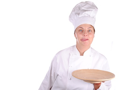 female chef showing a wooden dish, isolated on white Stock Photo