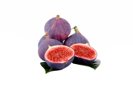 purple figs over leaves, isolated on white Stock Photo