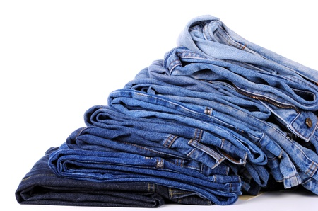 stack of different kind of blue jeans, on white background  photo