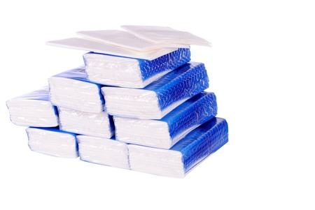 snotty: pile of paper handkerchief pockets isolated on white background