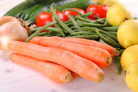 fresh organic vegetables on a wooden table