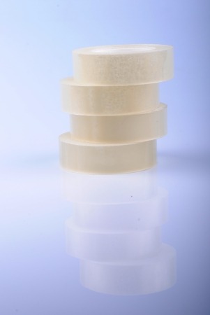 Transparent scotch tape rolls in a stack