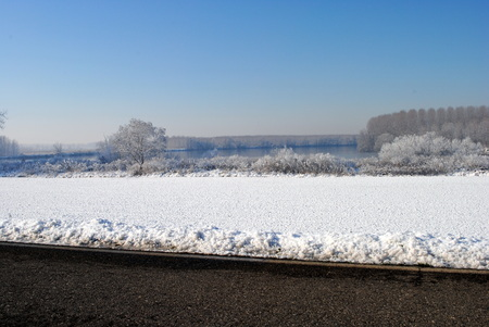 farmlands and a river covered by snow