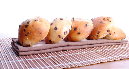 sweet bread with chocolate drops over bamboo placemat Stock Photo
