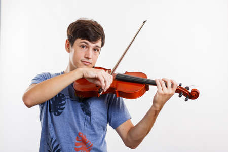 A Young violinist playing. Concept of music, hobby, art, lifestyle. Musician isolated. Black background.