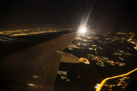 Aerial view of night city landscape. Earth viewed from airplane