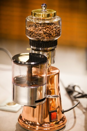 Small electric coffee machine. Kitchen household cooking appliance