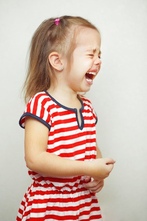Child with tears falling down girls young face Standard-Bild