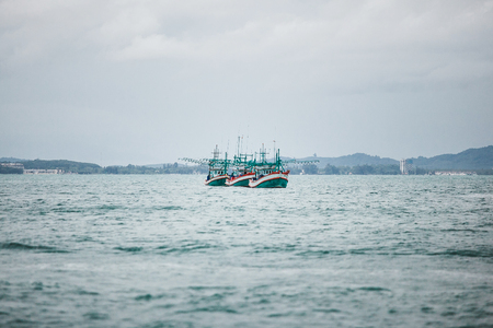 fishing boats sailing on the sea. three ships with fish. Stock Photo