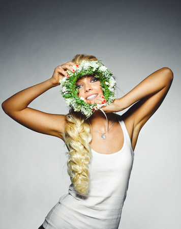cheerful woman with a floral wreath with face.