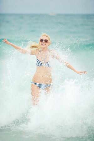 beautiful woman is demolished by sea wave. Stok Fotoğraf