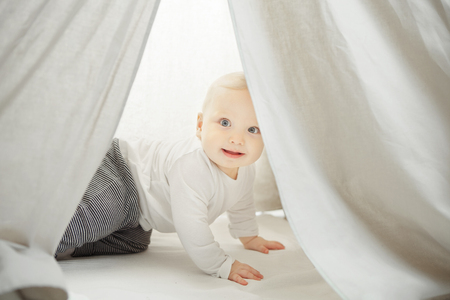 Curious child looks into the childrens wigwam