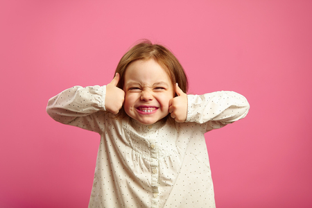 Funny shot of little girl with her thumbs up Stock Photo