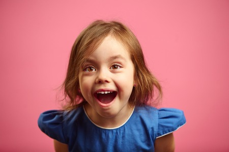 surprised little girl with eyes wide open and mouth