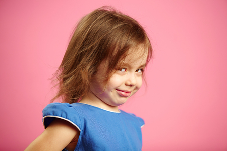 isolated portrait of little girl with a cunning look. Stock Photo