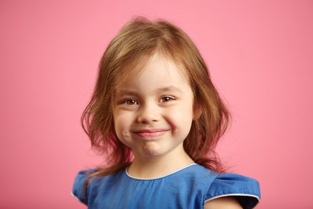 Portrait of children girl with beautiful and sincere smile. Imagens
