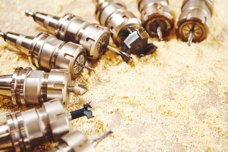 Woodworking bits for router machine on sawdust. Stock Photo