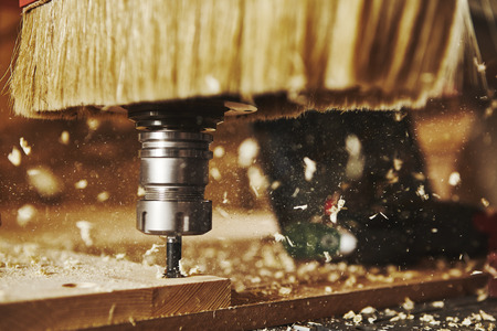 Close-up shot of machine with numerical control cuts wood. Cnc tool. Stock Photo