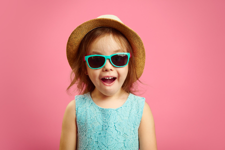 0e1fa31b981580 Portrait of surprised girl with open moutn, wears in panama hat and  sunglasses, expresses