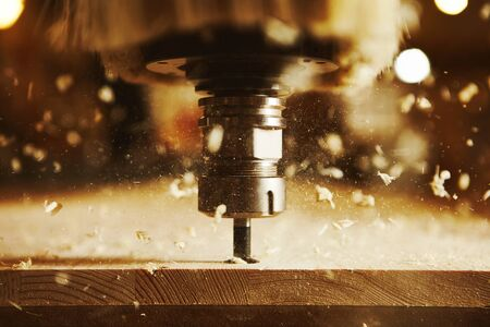 Close-up shot of machine with numerical control cuts wood. Cnc tool. Banco de Imagens - 125677608