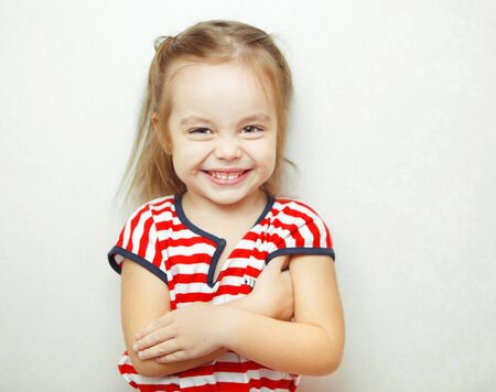 Little girl with broad sincere smile portrait photo Imagens