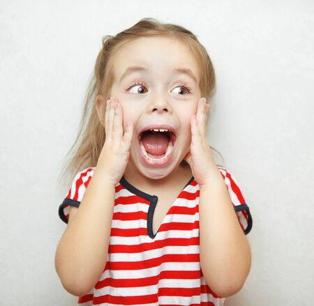 Funny little girl taken aback by great surprise Stockfoto