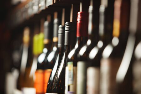 Wine cellar with elite drinks on shelves with written names Banque d'images - 135526366