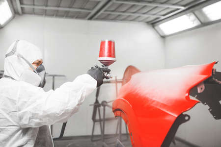Spraying the paint to the car detail. Paint coating business.