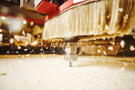 Close-up shot of cutting wood with a cnc milling machines.