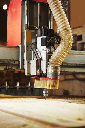 Cutting wood using a machine with numerical control. Cnc tool. Banco de Imagens