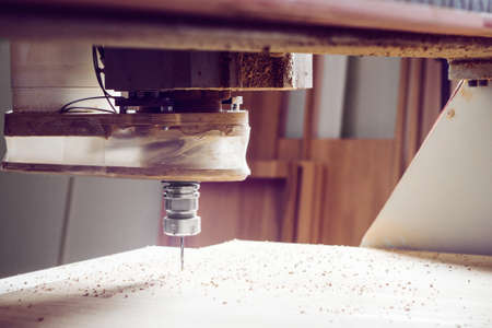 Cnc machine working, cutting wood. Woodwork industry.