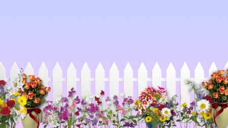 A white fence in the garden with flowers and plants Stock Photo