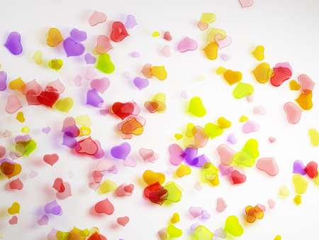 Valentines Day background. Lots of colorful hearts on white background photo