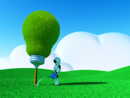The robot watering a green tree in shape of light bulb. photo