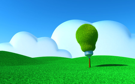Tree in the shape of light bulb grows on green field. Green energy concept photo