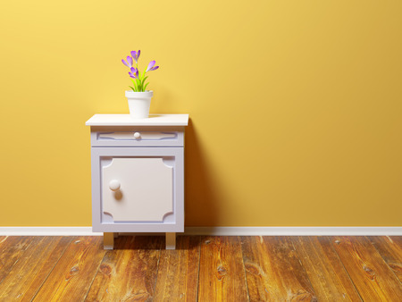 bedroom wall: classic nightstand with flower at the wall Stock Photo