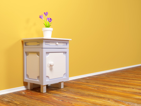 classic nightstand with flower at the wall photo