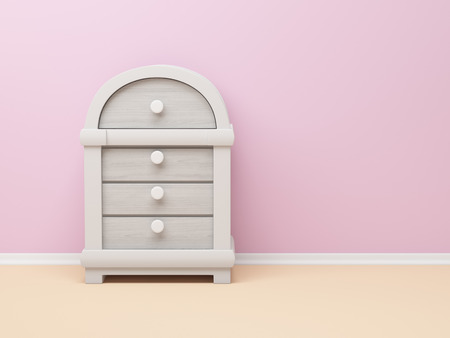 chest wall: dresser in fantasy style near the pink wall Stock Photo