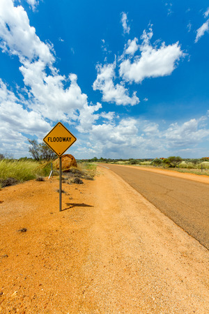 Australian Desert road with floodway sign photo