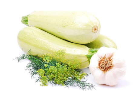 Zucchini, whole,  garlic, dill, isolated on a white background
